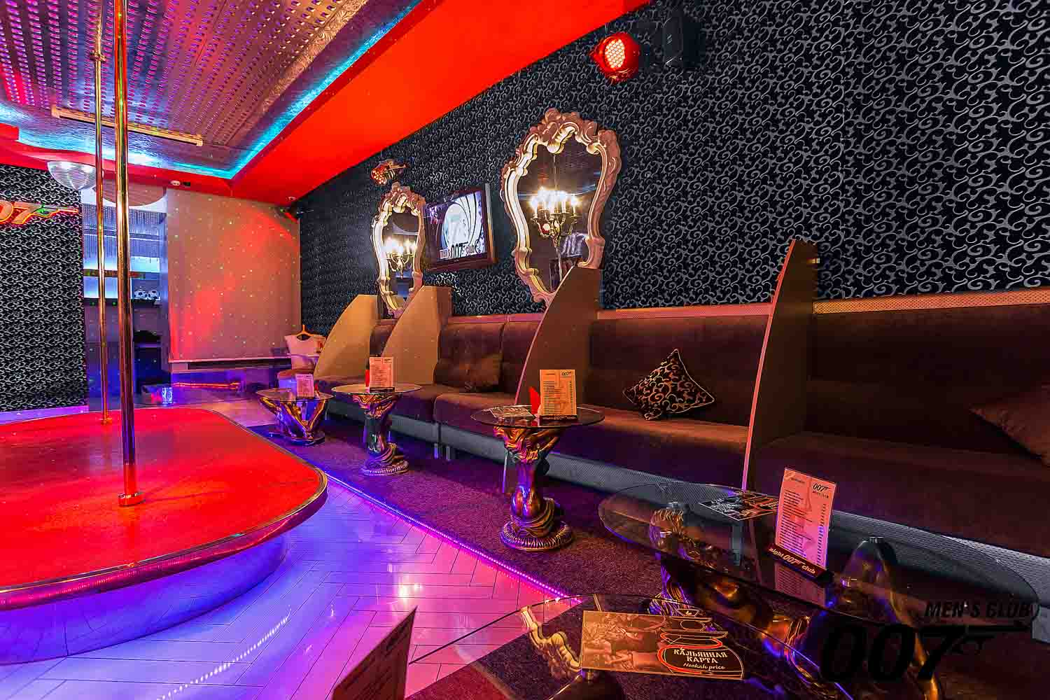 The strip club's interior is Men's Club 007